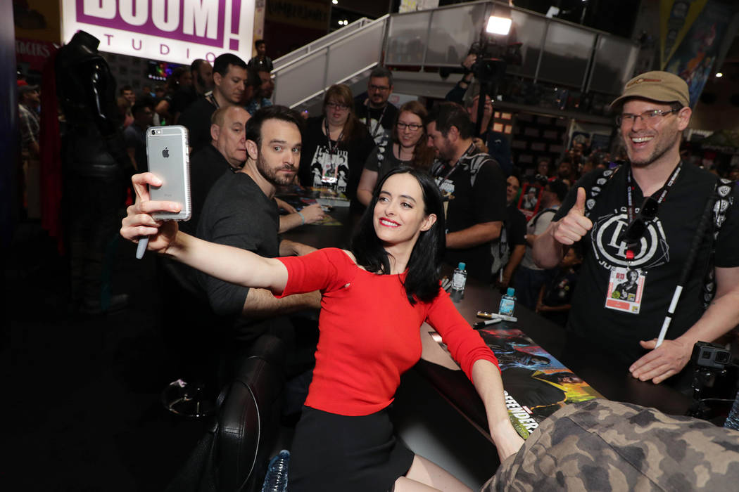 Krysten Ritter takes a selfie with a fan during an autograph signing on the convention floor during Comic-Con in San Diego. (Eric Charbonneau)