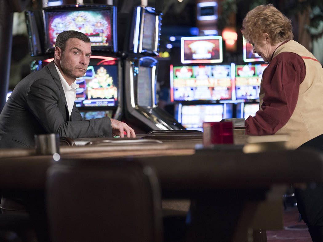 Liev Schreiber as Ray Donovan and Susan Berger as the dealer in Ray Donovan.  Michael Desmond Showtime