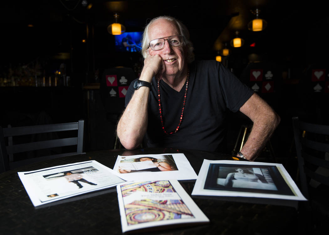 Poet Lee Mallory sits with photos of his daughter Misty Mallory, who passed, at the Sand Dollar Lounge in Las Vegas on Tuesday, Aug. 8, 2017. Chase Stevens Las Vegas Review-Journal @csstevensphoto