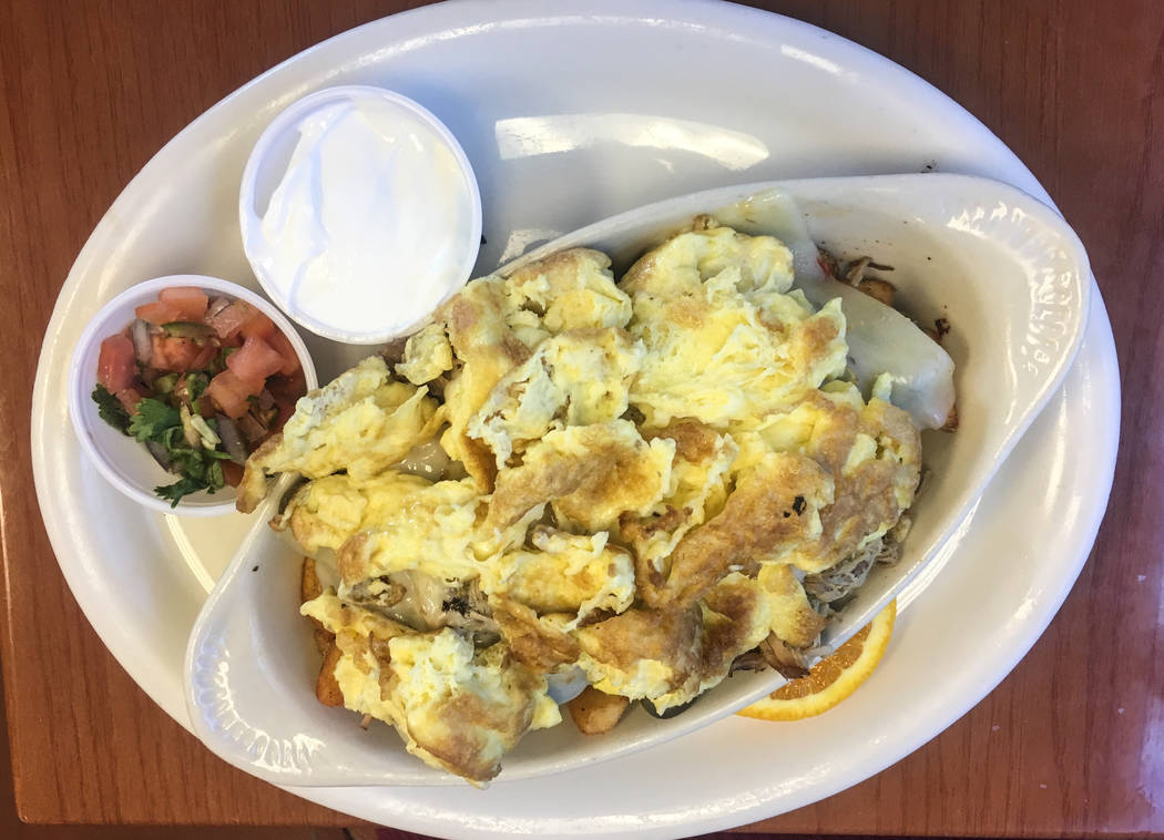The Mexican omelet, $9.95, is comprised of marinated carnitas, sliced jalapeños, fresh pico de gallo, pepper jack cheese and is topped off with sour cream. (Alex Meyer/View) @alxmey