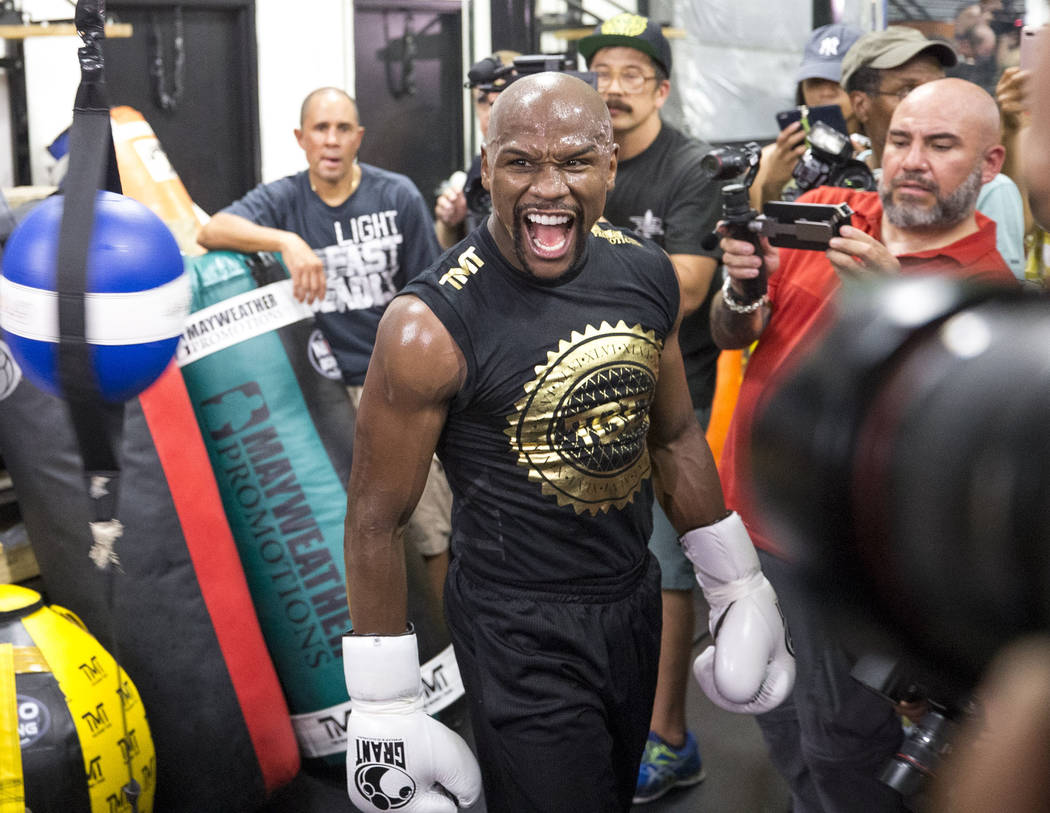 """Undefeated American boxer Floyd """"Money"""" Mayweather Jr. screams as he works out for the media at his gym on Thursday, August 10, 2017, in Las Vegas. Mayweather is scheduled to fig ..."""