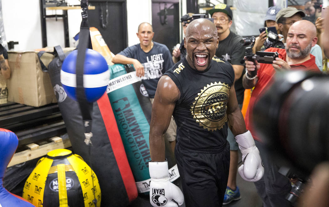 "Undefeated American boxer Floyd ""Money"" Mayweather Jr. screams as he works out for the media at his gym on Thursday, August 10, 2017, in Las Vegas. Mayweather is scheduled to fight Conor McGregor  ..."