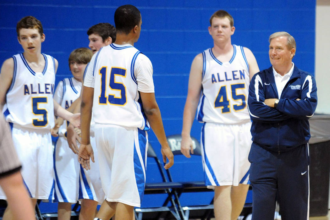 This Feb. 27, 2011 photo shows Allen Academy basketball coach Dave Bliss, right, during a high school basketball game in Bryan, Texas. (AP Photo/College Station Eagle, Dave McDermand)