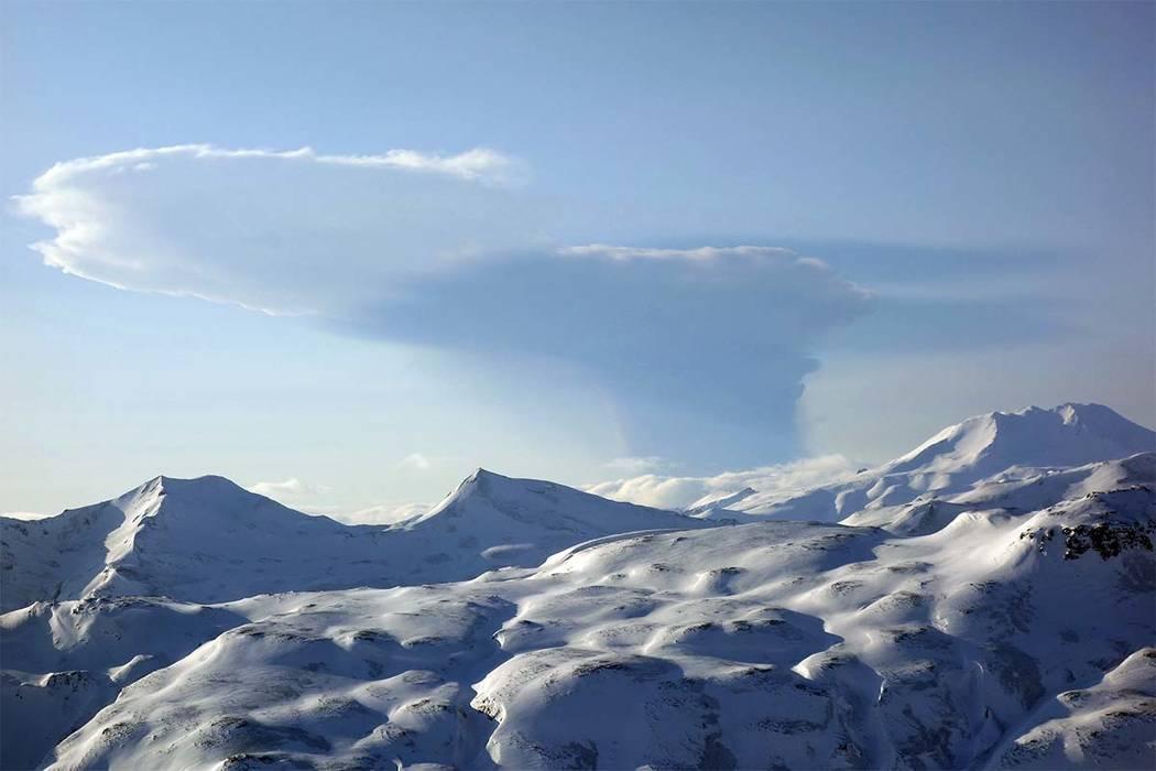 In this Feb. 19, 2017 aerial photo, released Alaska Volcano Observatory/Alaska Division of Geological & Geophysical Surveys shows the Bogoslof volcano eruption plume as seen from Unalaska Isla ...