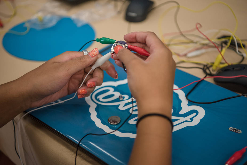 "Aysia, 14, working in the ""wearable technology"" station during Alexa Cafe, an all-girls tech camp, at the Girl Scouts of Southern Nevada on Tuesday, Aug. 8, 2017, in Las Vegas. (Morgan Lieberman/L ..."