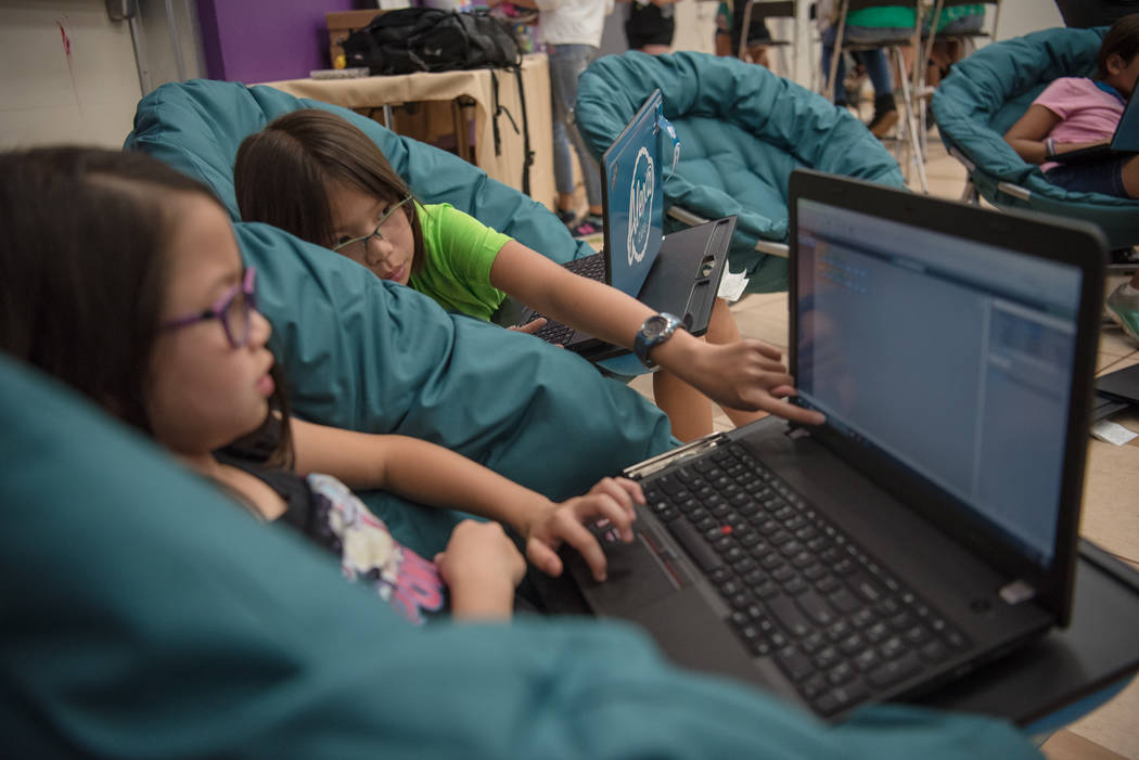 Sisters Kella, 9, left, and Gabi, 12, focus on video game development during Alexa Cafe, an all girls tech camp, at Girl Scouts of Southern Nevada on Tuesday, Aug. 8, 2017, in Las Vegas. (Morgan L ...