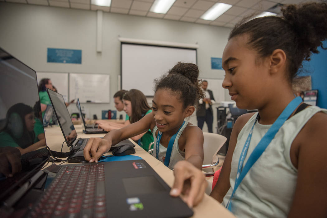 Sisters Nabrakissa, 10, center, and Nakamae, 11, right, help each other with their 3D modeling projects during Alexa Cafe, an all-girls tech camp, at the Girl Scouts of Southern Nevada on Tuesday, ...