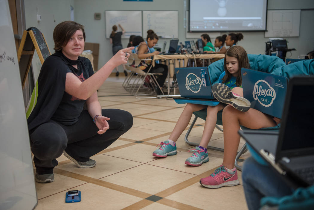 Heather Connor, left, gives the campers a quick lesson in decoding during Alexa Cafe, an all-girls tech camp, at the Girl Scouts of Southern Nevada on Tuesday, Aug. 8, 2017, in Las Vegas. (Morgan  ...
