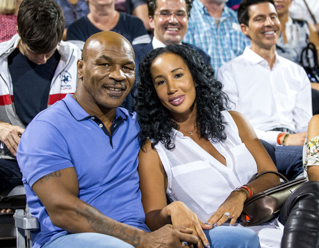 The 2016 World Team Tennis Smash Hits fundraiser benefiting The Elton John AIDS Foundation at Caesars Palace on Monday, Oct. 10, 2016, in Las Vegas. Mike Tyson and his wife, Lakiha Spicer, are pic ...