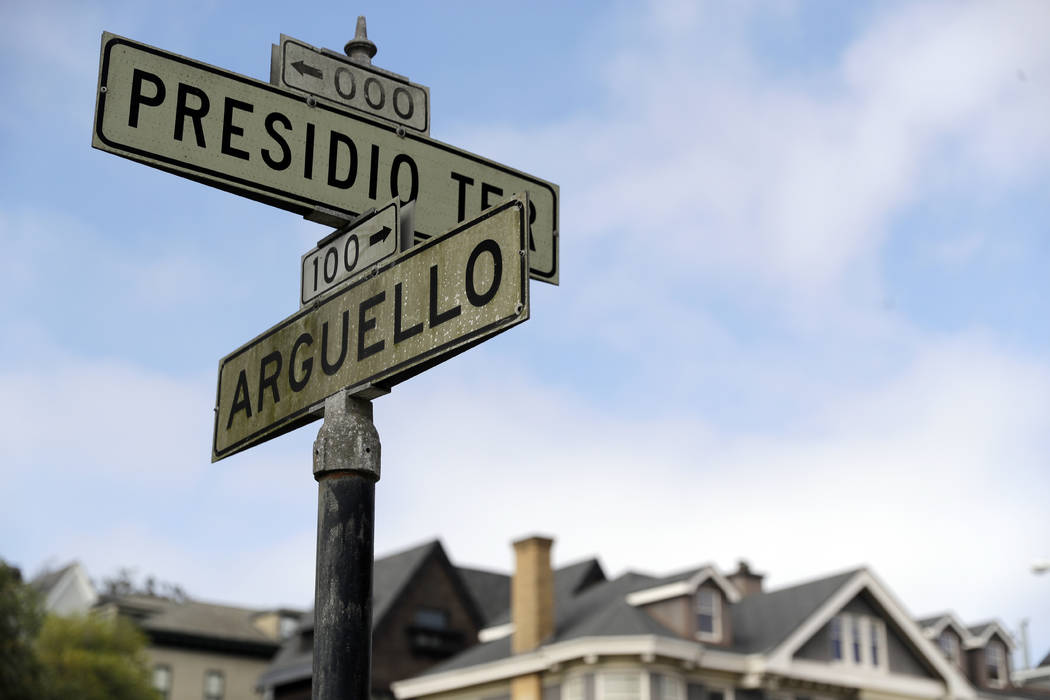 Street signs are seen at the intersection of Presidio Terrace and Arguello at the entrance to the Presidio Terrace neighborhood, Monday, Aug. 7, 2017, in San Francisco. Thanks to a city auction st ...