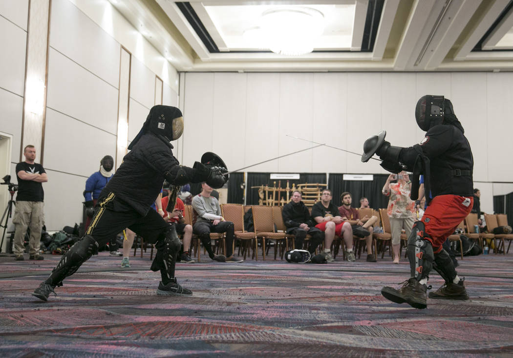 Jesse Tucker, left, of Vancouver fights with Howard Nenno, right, of San Jose during Combat Con at Flamingo hotel-casino in Las Vegas, Saturday, Aug. 12, 2017. Gabriella Angotti-Jones Las Vegas Re ...