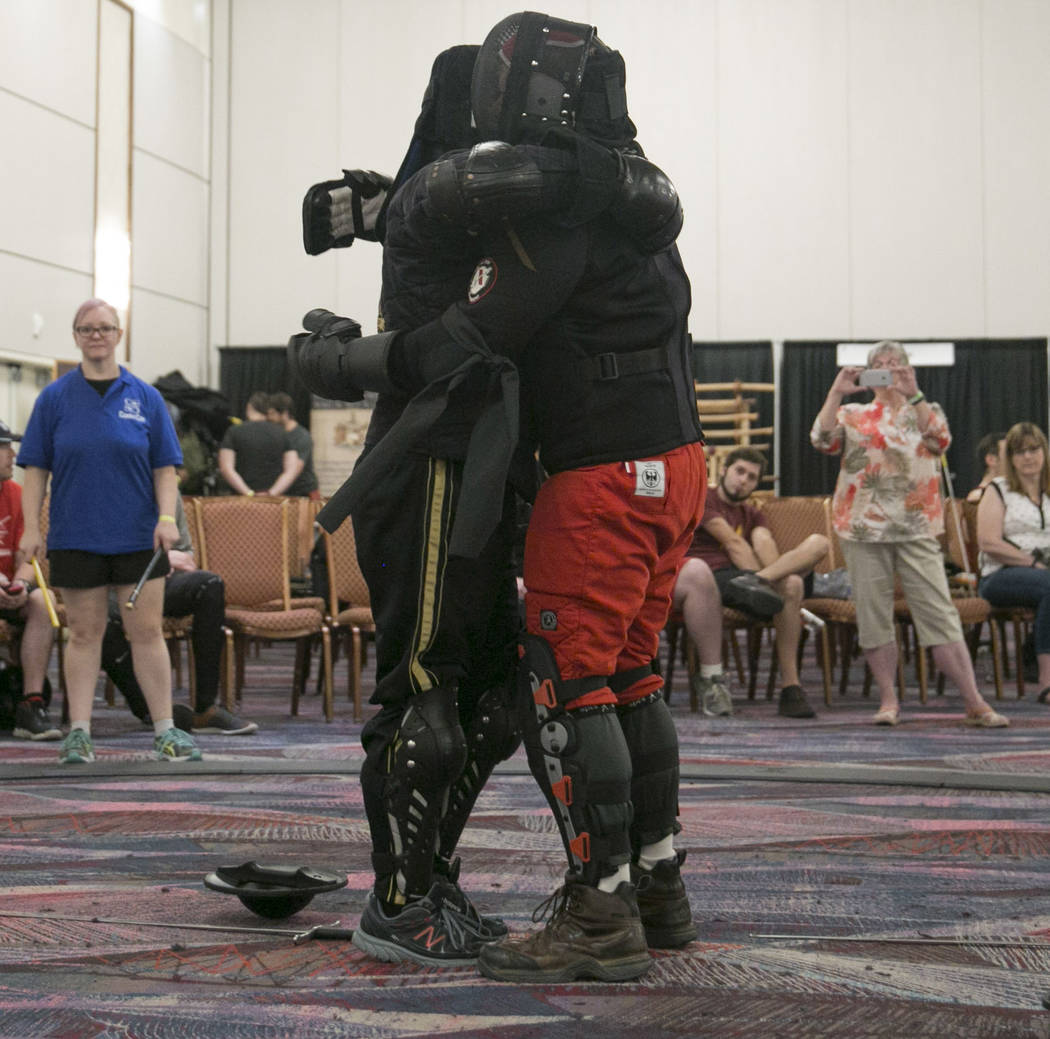 Jesse Tucker, left, of Vancouver embraces Howard Nenno, right, of San Jose after a tournament fight during Combat Con at Flamingo hotel-casino in Las Vegas, Saturday, Aug. 12, 2017. Gabriella Ango ...