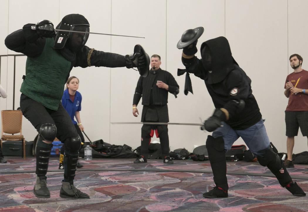 People fight a sword fighting tournament during Combat Con at Flamingo hotel-casino in Las Vegas, Saturday, Aug. 12, 2017. Gabriella Angotti-Jones Las Vegas Review-Journal @gabriellaangojo