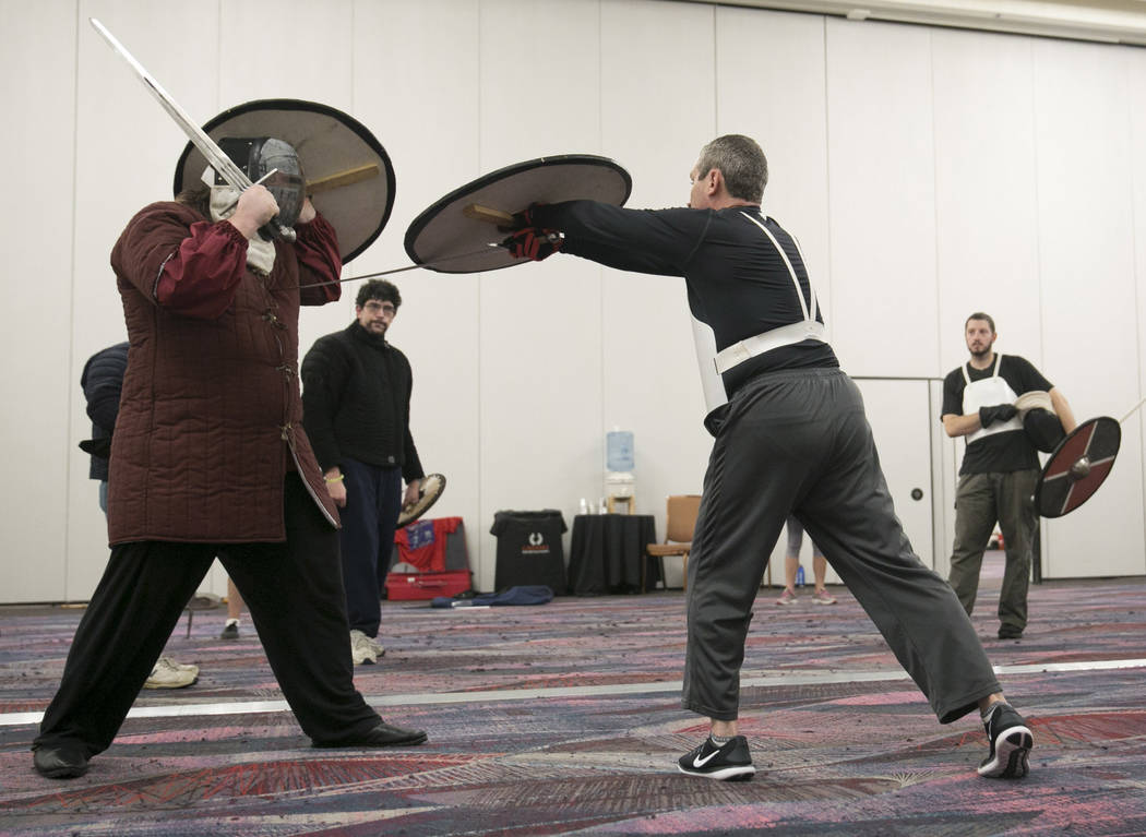 An instructor demonstrates an attack technique during a Byzantine combat class during Combat Con at Flamingo hotel-casino in Las Vegas, Saturday, Aug. 12, 2017. Gabriella Angotti-Jones Las Vegas R ...