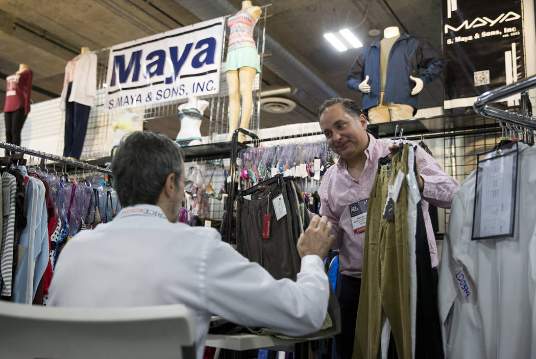 Paul Maya, right, president of S. Maya & Sons, works with a customer during the OFFPRICE Show at the Sands Expo and Convention Center in Las Vegas on Saturday, Aug. 12, 2017. Erik Verduzco Las ...