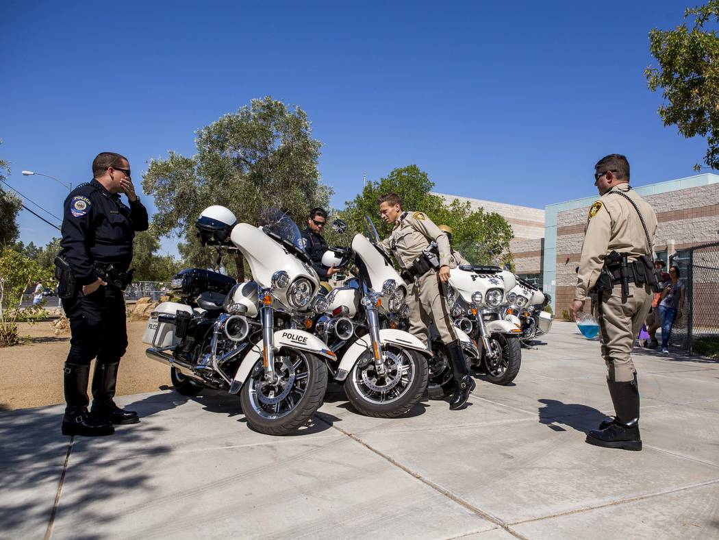 Metropolitan Police Department officers polish their motorcycles before a joint a news conference with Clark County School District police about back-to-school safety at Hal Smith Elementary Schoo ...