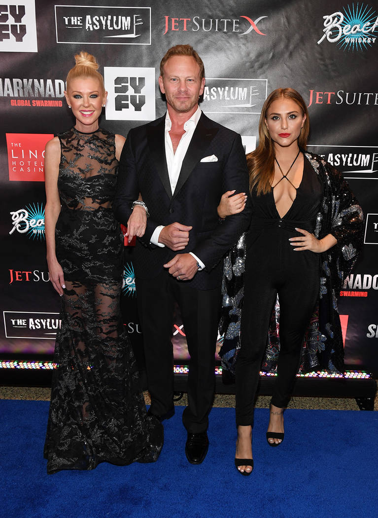 "Actress Tara Reid, left, actor Ian Ziering and actress Cassie Scerbo attend the premiere of ""Sharknado 5: Global Swarming."" (Ethan Miller/Getty Images for Caesars Entertainment)"