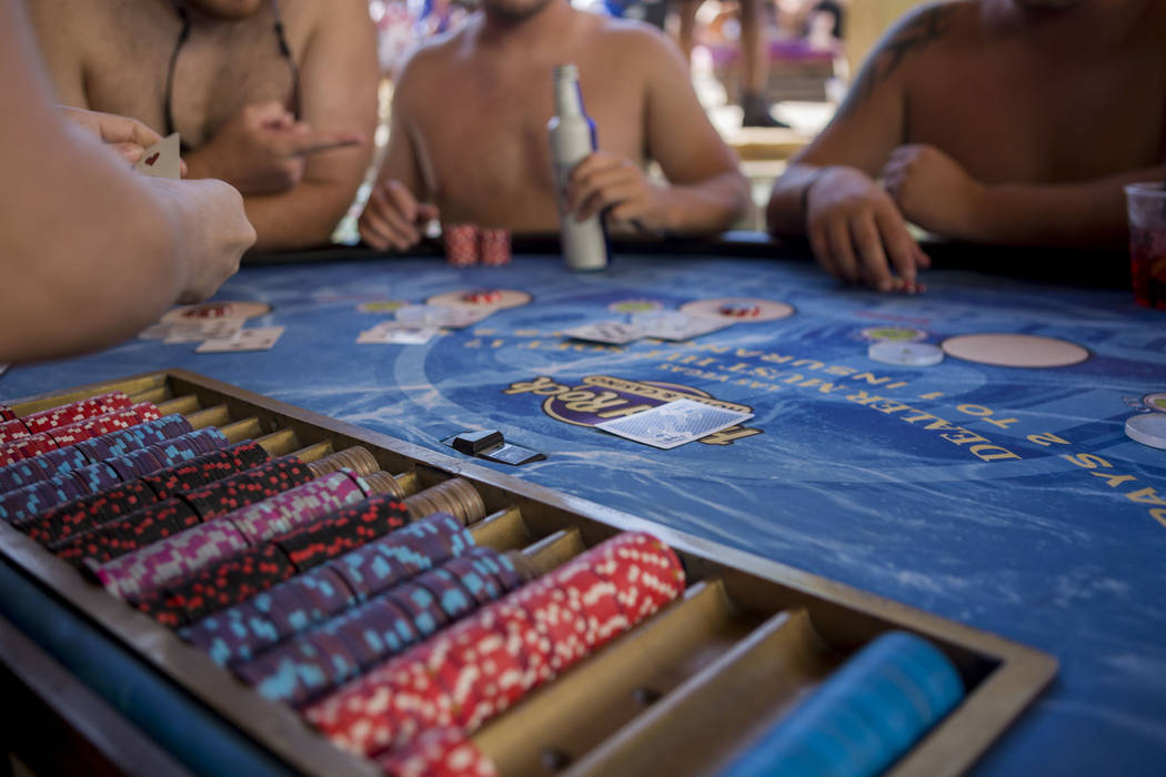 People play swim-up blackjack while listening to Shaquille O'Neal perform as DJ Diesel at Rehab Beach Club at the Hard Rock hotel-casino, Sunday, Aug. 13, 2017. Elizabeth Brumley Las Vegas Review- ...
