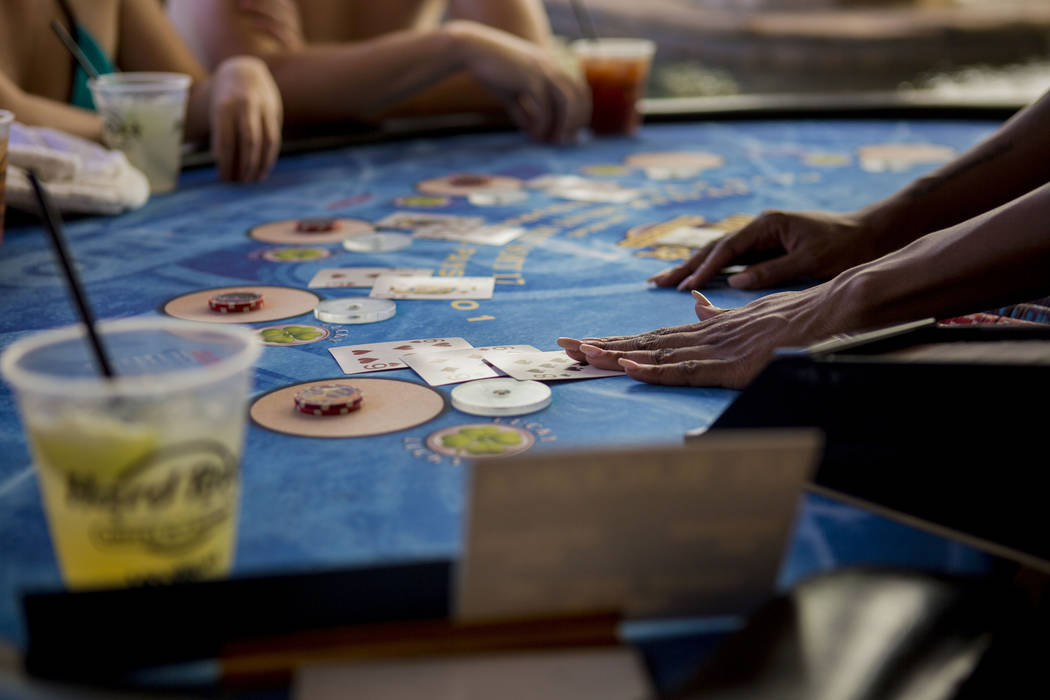 People play swim-up Black Jack while listening to Shaquille O'Neal perform as DJ Diesel at Rehab Beach Club at the Hard Rock hotel-casino, Sunday, Aug. 13, 2017. Elizabeth Brumley Las Vegas Review ...