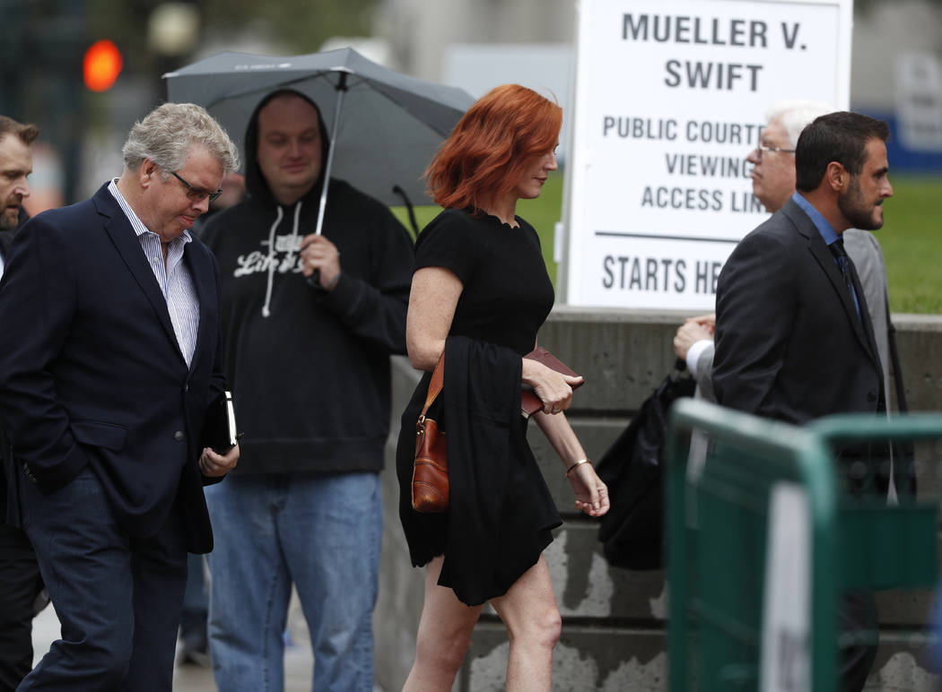 Tree Paine, center, publicist to singer Taylor Swift, walks with a phalanx of men to attend the jury selection phase in a civil trial to determine whether a radio host groped pop singer as the cas ...