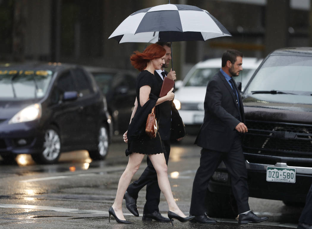 Tree Paine, publicist for pop singer Taylor Swift, walks back to a hotel after attending the jury selection phase in a civil trial in federal court, Monday, Aug. 7, 2017, in Denver, to determine w ...