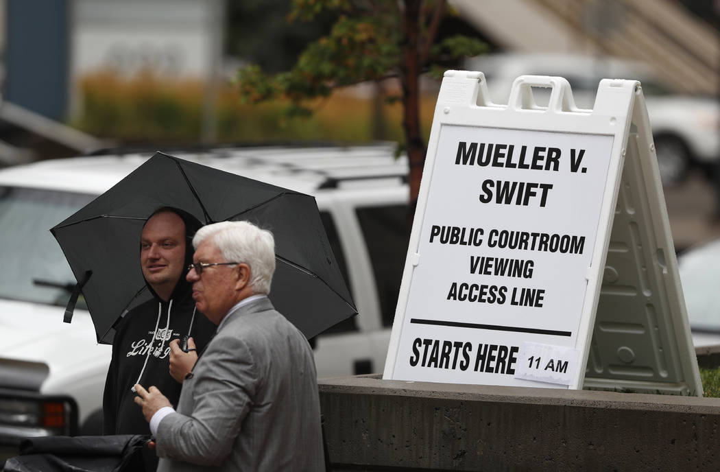 Members of the public Arthur Lewis, left, and Bruce Conant, both of Denver, wait to attend the jury selection phase in a civil trial to determine whether a radio host groped pop singer Taylor Swif ...