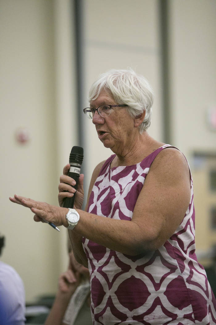 Cathy Wagner, a resident of the  Paradise township, voices her opinion about the Raiders stadium project during a Paradise Town Advisory Board meeting at the Clark County Operations Center in Las  ...