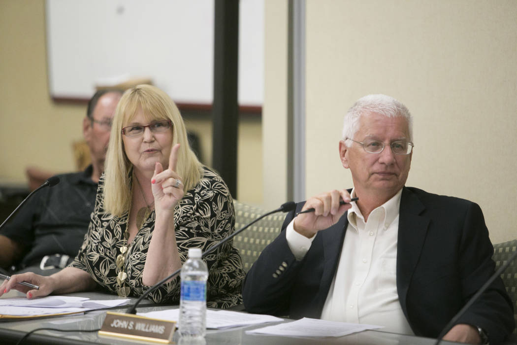Members of the of the Paradise Town Advisory Board, from left: Susan Philipp, Chair, and John Williams, listen to a presentation on the Raiders stadium project during a  meeting at the Clark Count ...