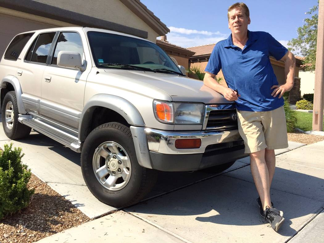 Findlay Toyota Sportscaster Ron Futrell is seen with his 1996 Toyota 4Runner purchased new from a Findlay Automotive Group dealership. The 4Runner is still running strong with more than 400,000 miles.
