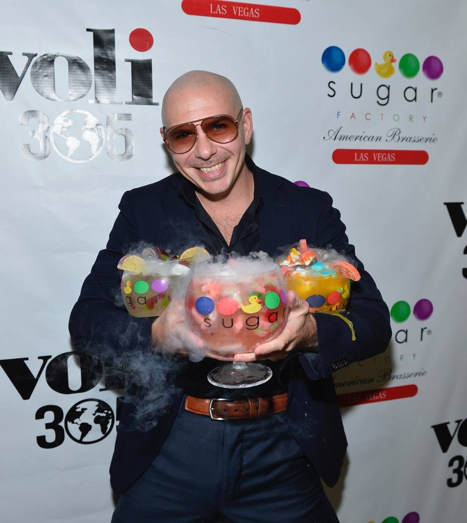 Pitbull holds his 3 new signature Voli 305 Sugar Factory goblets. Bryan Steffy