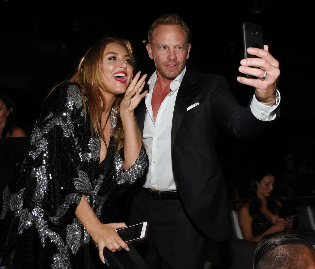 "Actress Cassie Scerbo and actor Ian Ziering live-stream during the premiere of ""Sharknado 5: Global Swarming"" at The LINQ Hotel & Casino on August 6, 2017 in Las Vegas, Nevada.  Ethan Miller/G ..."