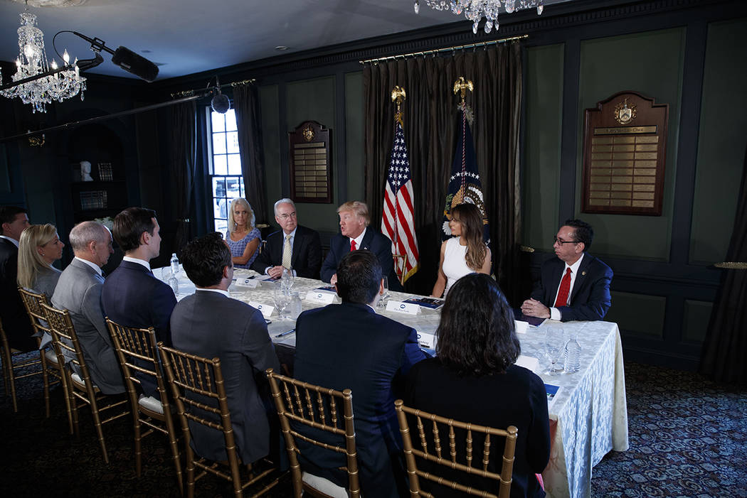 President Donald Trump speaks during a briefing on the opioid crisis, Tuesday, Aug. 8, 2017, at Trump National Golf Club in Bedminster, N.J. From left are, White House senior adviser Kellyanne Con ...