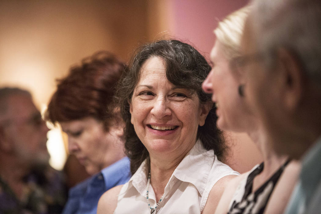 """Las Vegas writer H.G. McKinnis interacts with guests during a signing party and reading for her first novel, """"A Justified Bitch,"""" at the Writer's Block on Tuesday, Aug 8, 2017, in Las Vegas. Benja ..."""