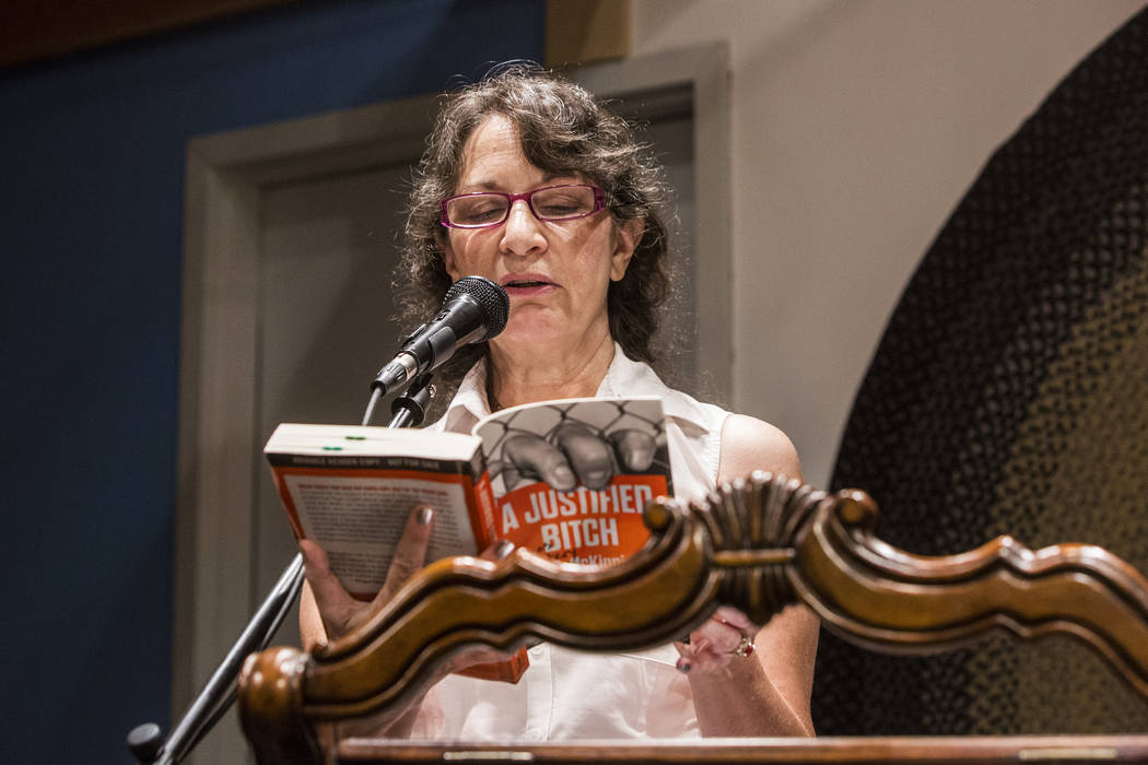"""Las Vegas writer H.G. McKinnis reads from her novel, """"A Justified Bitch,"""" during a book release party at the Writer's Block on Tuesday, Aug 8, 2017, in Las Vegas. Benjamin Hager Las Vegas Review-J ..."""