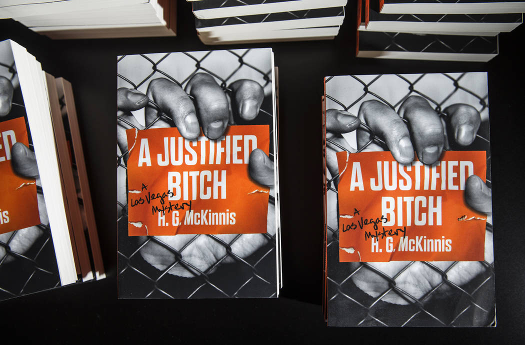 """Copies of Las Vegas writer H.G. McKinnis' first novel, """"A Justified Bitch,"""" fill a table during a signing party and reading at the Writer's Block on Tuesday, Aug 8, 2017, in Las Vegas. Benjamin Ha ..."""