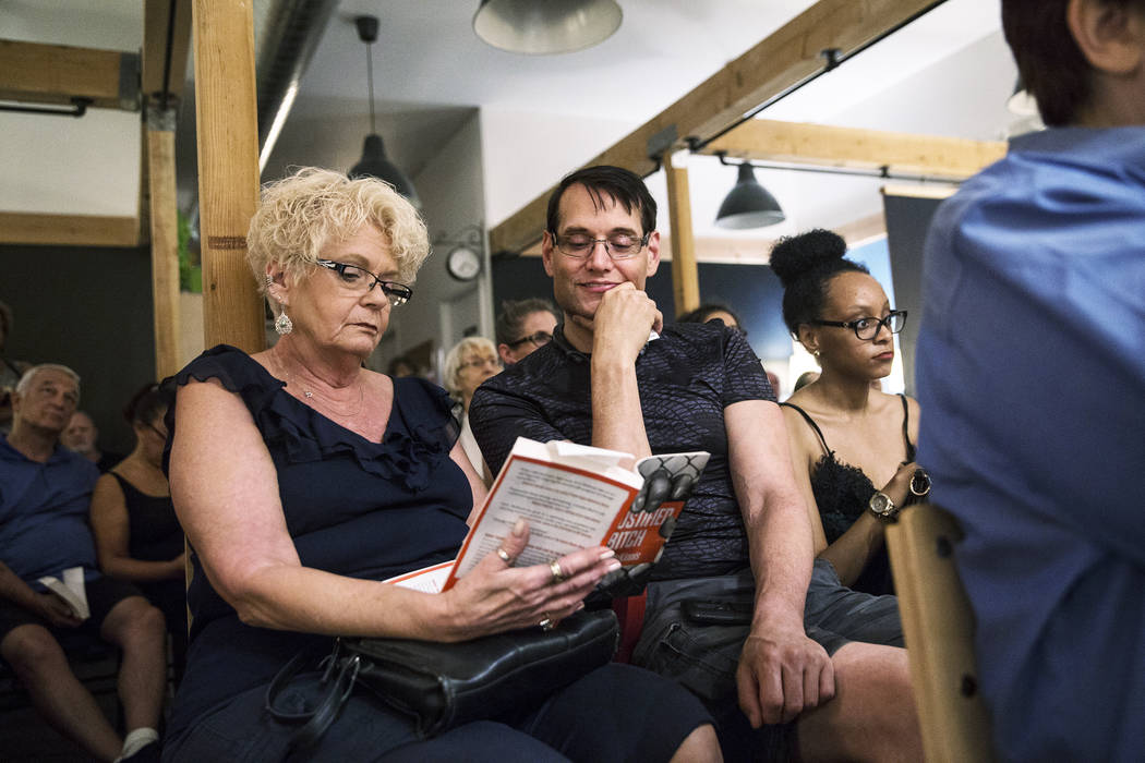 Guests at Las Vegas writer H.G. McKinnis' book release party read along with the author at the Writer's Block on Tuesday, Aug 8, 2017, in Las Vegas. Benjamin Hager Las Vegas Review-Journal @benjam ...