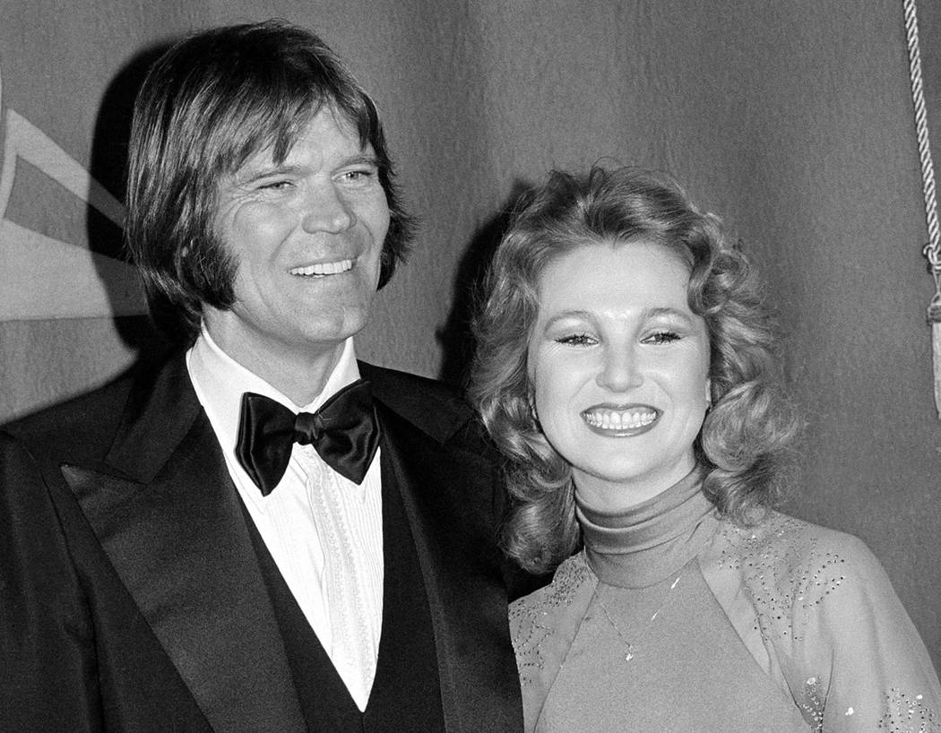FILE - In this Feb. 15, 1979 file photo, country singers Glen Campbell, left, and Tanya Tucker, engaged to one another, are shown at the Grammy Awards in Los Angeles. Campbell, the grinning, high- ...