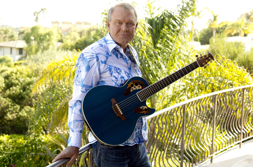 "FILE - In this July 27, 2011 photo, musician Glen Campbell poses for a portrait in Malibu, Calif. Campbell, the grinning, high-pitched entertainer who had such hits as ""Rhinestone Cowboy& ..."