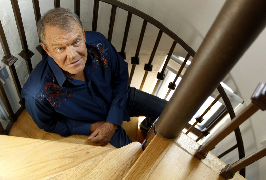"In this July 27, 2011 photo, musician Glen Campbell poses for a portrait in Malibu, Calif. Campbell, the grinning, high-pitched entertainer who had such hits as ""Rhinestone Cowboy&quo ..."