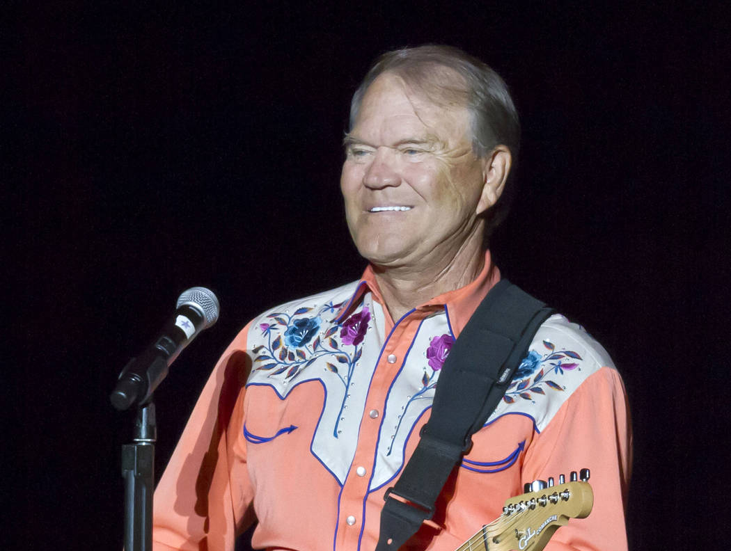 FILE - This Sept. 6, 2012 file photo shows singer Glen Campbell performing during his Goodbye Tour in Little Rock, Ark. Campbell, the grinning, high-pitched entertainer who had such hits as &q ...