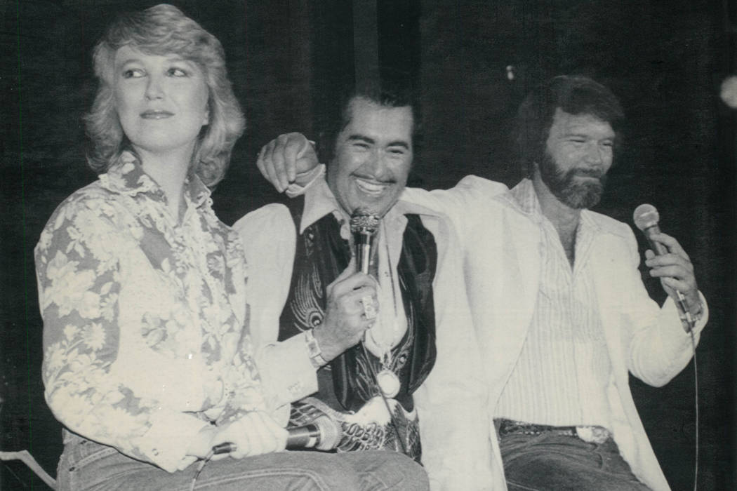 Country music newlyweds Tanya Tucker, left, and Glen Campbell, right, surprised singer Wayne Newton, center, during his performance Oct. 7, 1980, at the Aladdin in Las Vegas. The married couple wa ...