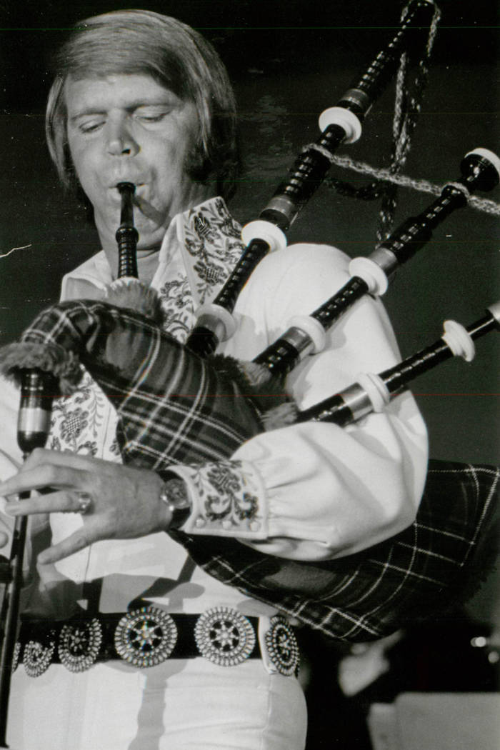 Glen Campbell plays the bagpipes during a performance in Las Vegas. (Las Vegas News Bureau)