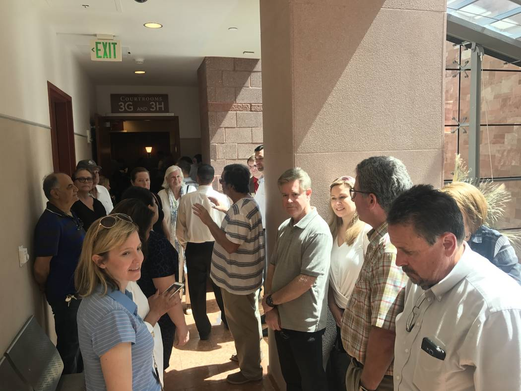 Homeowners who live near the now-shuttered Legacy Golf Club in Henderson wait outside the hall for news on a motion filed by residents of the Grand Legacy Community Association and four other comm ...