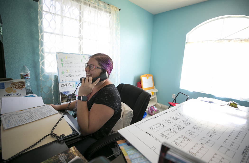 Bridal Spectacular Vice President Laura Covington calls a clients from her office on Friday, Aug. 11, 2017, in preparation for her two-day bridal show at Cashman Center on August 18-19. Richard Br ...