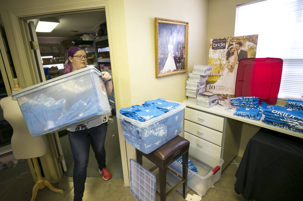 Bridal Spectacular Vice President Laura Covington organizes T-shirts at her office on Friday, Aug. 11, 2017, in preparation for her two-day bridal show at Cashman Center on August 18-19. Richard B ...