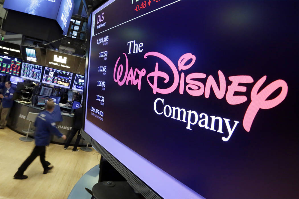 The Walt Disney Co. logo appears on a screen above the floor of the New York Stock Exchange on Monday, Aug. 7, 2017. The Walt Disney Co. reports earnings, Tuesday, Aug. 8, 2017. (AP Photo/Richard  ...