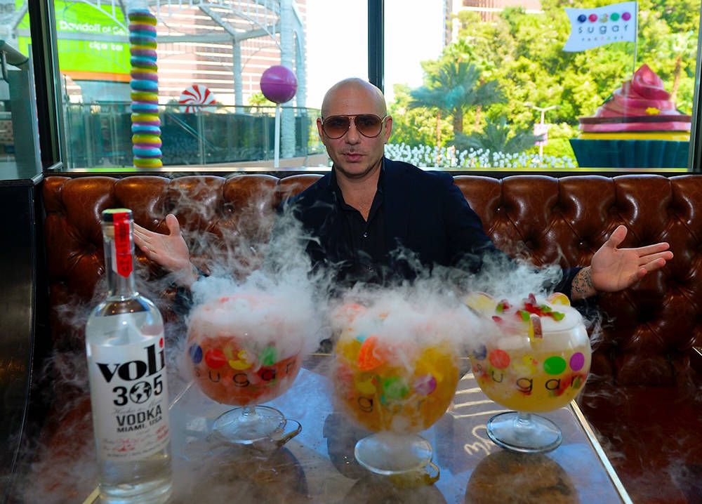 Planet Hollywood Resort headliner Pitbull designed and tasted the drinks made from Voli 305 including Watermelon Patch, Fuzzy Peach Penguin and Hot & Wild Spicy 305 Pineapple at the  Sugar Fac ...