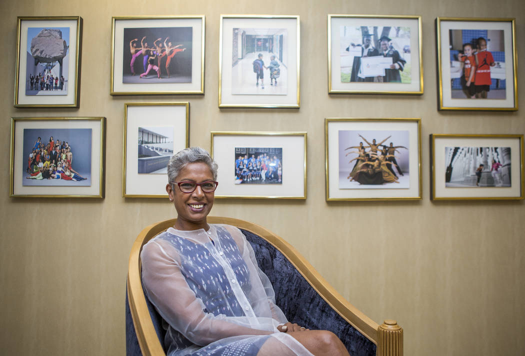 Philanthropist Punam Mathur in front of photos of  people and groups the Elaine P. Wynn & Family Foundation has helped in the foundation's office in Las Vegas on Aug. 10, 2017.  Patrick Connol ...