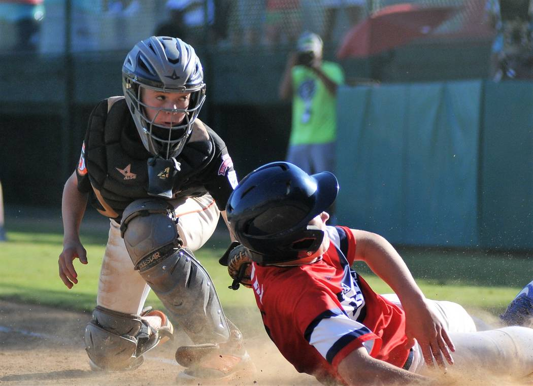 Utahճ Seth Wells, right,  just beats the tag of Summerlin South catcher Mikey Albanese in the fourth inning of Utahճ 8-5 victory over Summerlin South in Little Leagueճ West Regio ...