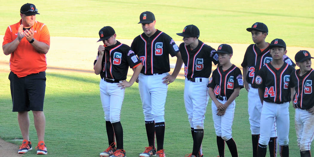 Summerlin South manager Adam Grant applauds his team after their 8-5 loss against Utah Little League's West Regional Tournament in San Bernardino, Calif, Tuesday, Aug. 8, 2017. Lou Ponsi La ...
